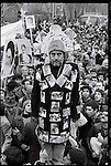 "A pro-Khomeini demonstrator dons a jacket decorated with photographs of victims of the shah's repression and a hat that reads ""crown of the martyrs."" Tehran, January 19, 1979."