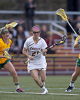 Boston College midfielder Kristin Igoe (21) on the attack. Boston College defeated University of Vermont, 15-9, at Newton Campus Field, April 4, 2012.