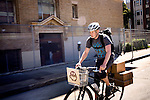 Brandon McGee rides his bike for deliveries in San Franicsco, Ca., on Monday, April 4, 2011. Bicycle Coffee Company is a San Francisco start-up taking green to a new level, by delivering hand-roasted coffee to over 100 local businesses, in addition to Whole Foods, by bicycle only. .Lianne Milton for The Wall Street Journal.Bay Area - Coffee Status