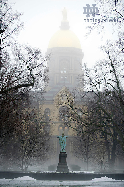January 17, 2012; The Golden Dome and Statue of Jesus are enveloped by fog mid morning. Photo by Barbara Johnston/University of Notre Dame