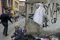 Trash market in Kurtulus neighborhood.  Immigrants and gypsies sell a variety of things... including things they found in the trash... thus the name..Turkey is primarily affected by internal migration.  Istanbul was 2 million 30 years ago and is now 12 million.  People I photographed in Yayla (Agricultural) lifestyle 10 years ago are now all office workers in Istanbul.  There just isn't a good way to make a living in the rural areas anymore.  In 30 years Turkey has gone from being 70 percent rural to 70 percent urban.  The average in the world is 51 percent urban..Turkey is also a spinning top for migration to Europe from Iraq, Iran, Afghanistan and Sudan.  Sudanese go first to Libya and then on to Turkey.  Turkey is very late to the party to deal with immigration and one of the factors for EU membership is that they need to deal with this.  They are still working off a 1951 law that limits immigration to ONLY wealthy west Europe countries.  Meanwhile Africa receives more refugees than Europe.  250,000 foreigners seek a better life by moving THROUGH Turkey, but few want to stay.  But if you are Muslim you tend to stay longer.  According to the UNHCR lawyer here Muslims are not considered &quot;good&quot; refugees by many EU countries and the USA.  Even though Turkey does not officially welcome anyone outside the geographic restriction of wester Europe, they are more humane to them once they sneek into the country.  UNHCR helps them get hospital care and their children into schools... relief organizations treat them as the &quot;guest&quot; that has such a special place in the Islamic religion.  According the the UNHCR lawyer the criminilization of immigration is the worst part of this whole scene.