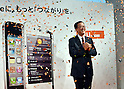 October 14, 2011, Tokyo, Japan - Koji Tanaka, president of KDDI, is all smiles as he kicks off the sales of Apple iPhone 4S at its design studio in Tokyos Harajuku section on Friday, October 14, 2011..KDDI went head-on with Softbank, trying to end Softbank's highly profitable reign as the sole provider in Japan as Apples new smartphone went on sale in the country. Apple stores also started selling the iPhone 4S on a first-come, first-served basis without accepting preorders. (Photo by Natsuki Sakai/AFLO)