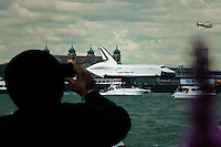 A man takes pictures of the Space Shuttle Enterprise when it makes its way up by Hudson River to be placed at the Intrepid Sea, Air and Space Museum in New York, June 6, 2012.  Photo by Kena Betancur / VIEW..