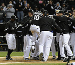 CHICAGO - APRIL 12:  Alexei Ramirez #10 of the Chicago White Sox is mobbed by teammates at home plate after hitting a walk-off game winning home run off of Bobby Cramer #26 of the Oakland Athletics in the 10th inning on April 12, 2011 at U.S. Cellular Field in Chicago, Illinois.  The White Sox defeated the Athletics 6-5.  (Photo by Ron Vesely)  Subject:  Alexei Ramirez;Bobby Cramer.