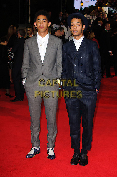 """Rizzle Kicks.Royal World Premiere of 'Skyfall' held at the Royal Albert Hall, London, England..October 23rd, 2012.full length white blue grey gray shirt suit hands in pockets band group Jordan """"Rizzle"""" Stephens, Harley """"Sylvester"""" Alexander-Sule.CAP/CJ.©Chris Joseph/Capital Pictures."""