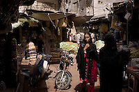 In the alleyways of a Lyari marketplace in Karachi - such neighborhoods retain their hussle and bussle, but are no longer the drivers of the culture ane economic life of the city.  few of the new middle and emerging middle class come here as more modern shopping centers have opened up across the city and provide greater variety, air-conditioned convenience and better hygienic produce.