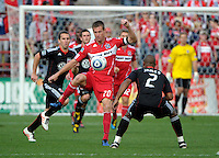 Chicago Fire forward Brian McBride (20) plays the ball in front of DC United defender Julius James (2).  The Chicago Fire tied DC United 0-0 at Toyota Park in Bridgeview, IL on Oct. 16, 2010.