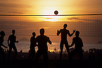 Futevolei (or footvolley), the beach volleyball game played using only feet, chest and head to hit the ball, Ipanema beach, Rio de Janeiro, Brazil.