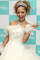 "July 31, 2010 - Tokyo, Japan - Japanese fashion model Jun Komori smiles as she wears a wedding dress for the Tokyo Wedding Collection 2010 Autumn & Winter fashion show held in Tokyo International Forum, Japan, on July 31, 2010. Jun Komori is one of the most popular Popteen's model, one of the ""gyaru"" magazines that combines fashion, celebrity gossip and other tabloid content and target women in their mid-20s."