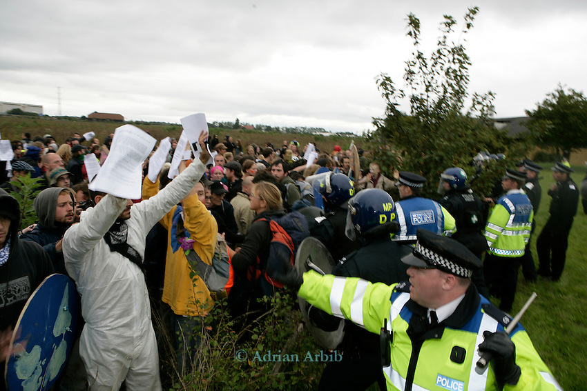 Climate change protesters face up to riot police as they attempt to get to the BAA offices<br /> Climate Camp, Heathrow . 2,000 protesters gathered at an impromptu camp set up to protest against  the UK's airport expansion program.
