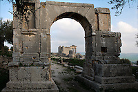General view of the Arch of Alexander Severus, 3rd century, with the Roman Capitol in the background, in Dougga, Tunisia, pictured on January 31, 2008, in the morning. Dougga has been occupied since the 2nd Millennium BC, well before the Phoenicians arrived in Tunisia. It was ruled by Carthage from the 4th century BC, then by Numidians, who called it Thugga and finally taken over by the Romans in the 2nd century. Situated in the north of Tunisia, the site became a UNESCO World Heritage Site in 1997. Picture by Manuel Cohen.