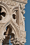 Detail of the sculptures of angels on the facade of the Doge's Palace in Venice, Italy