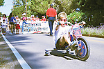 Zach Phillips breaks away from the pack at the Los Altos Hills Fourth of July parade.