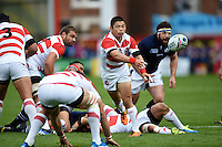 Fumiaki Tanaka of Japan passes the ball. Rugby World Cup Pool B match between Scotland and Japan on September 23, 2015 at Kingsholm Stadium in Gloucester, England. Photo by: Patrick Khachfe / Onside Images