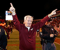 CHARLOTTESVILLE, VA- NOVEMBER 12: Head coach Frank Beamer with the Virginia Tech Hokies celebrates after the 38-0 win over the Virginia Cavaliers on November 28, 2011 at Scott Stadium in Charlottesville, Virginia.  (Photo by Andrew Shurtleff/Getty Images) *** Local Caption *** Frank Beamer