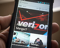 The AOL app on an Android phone on Tuesday, January 6, 2015. Verizon Communications is reported to have approached AOL regarding an acquisition or a joint venture. The telecommunications giant is interested in expanding mobile video and AOL's automated advertising technology.