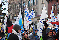 Montreal, CANADA - Nov 29 - People take to the street of Montreal and Quebec city to protest against the austerity measure of Philippe Couillard Liberal Governement, November 29, 2014,<br /> <br /> Photo : Agence Quebec Pressse - Philippe Nguyen
