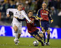 Chris Birchall, left, and Ned Grabavoy, right, battle for a ball in the second half of play. .Real Salt Lake defeated the Los Angles Galaxy on penalty kicks to win the 2009 MLS Cup at Qwest Field, Sunday, Nov. 22, 2009.