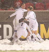USA's Abby Wambach (L), Shannon Boxx (C) and Kristine Lilly (R) celebrate a goal against Mexico at Rio Tinto Stadium March 31, 2010 in Salt Lake City, Utah. The USA women won the match over Mexico 1-0.