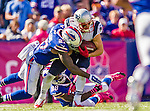 12 October 2014: New England Patriots wide receiver Julian Edelman (11) is tackled by strong safety Duke Williams (27) during a game against the Buffalo Bills at Ralph Wilson Stadium in Orchard Park, NY. The Patriots defeated the Bills 37-22 to move into first place in the AFC Eastern Division. Mandatory Credit: Ed Wolfstein Photo *** RAW (NEF) Image File Available ***