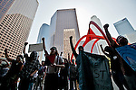 Occupy LA in it's 13 day. A small group of protesters marched from LA city hall to the Bank of America building in downtown LA. They chanted and held a peaceful rally on the front steps of the giant bank building.