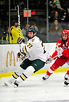 9 January 2011: University of Vermont Catamount forward Josh Burrows, a Senior from Prairie Grove, IL, in action against the Boston University Terriers at Gutterson Fieldhouse in Burlington, Vermont. The Catamounts fell to the Terriers 4-2 in Hockey East play. Mandatory Credit: Ed Wolfstein Photo
