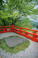 A single large stone and an orange fence is enough to create a lovely garden like this one on Mount Kurama.