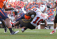 Nov 13, 2010; Charlottesville, VA, USA; Virginia Cavaliers safety Corey Mosley (7) can't hold Maryland Terrapins running back D.J. Adams (10) from scoring a touchdown during the 1st half of the game at Scott Stadium.  Mandatory Credit: Andrew Shurtleff