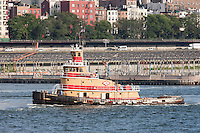 Tugboat Jill Reinauer on the East River passing by Brooklyn Bridge Park