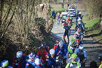 Michael Schwarzmann(DEU/Bora) stranded by a mechanical while the peloton whooshes him by up the Oude Kwaremont<br /> <br /> Kuurne-Brussel-Kuurne 2016