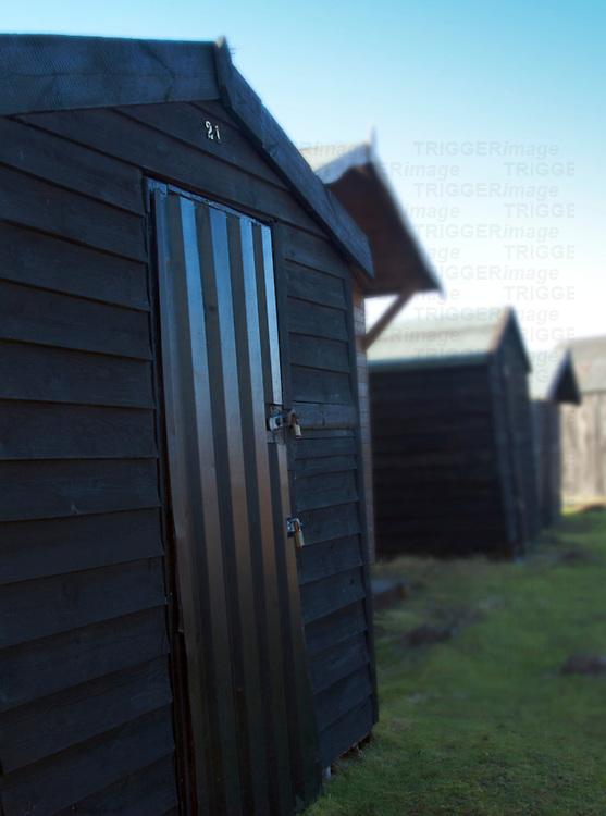 Black beach huts at Walberswick Suffolk England