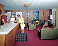 All Star Motel in Wildwood, New Jersey. Family checking in at the front desk of the retro lobby. 1960's retro photograph.