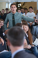 Moscow, Russia, 06/09/2011..A student in military uniform at the Economics Faculty questions Russian billionaire businessman Mikhail Prokhorov, newly elected leader of pro-business political party Right Cause, during a meeting at the Moscow State University.