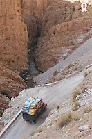 Morocco, Dades Valley, heavilly loaded truck on road, elevated view (Licence this image exclusively with Getty: http://www.gettyimages.com/detail/200387974-001 )