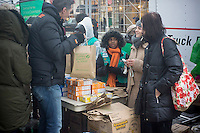 Intrepid Girl Scout cookie lovers brave the winter weather to line up to buy cookies on National Girl Scout Cookie Day in New York on Friday, February 8, 2013. Despite an impending blizzard the Girl Scouts came out to host a mobile bakery and food truck selling their famous cookies. Airlines have canceled over 3000 flights and New York Mayor Bloomberg is urging workers to leave early as a storm approaches the city with an expected snowfall of up to 14 inches.  (© Richard B. Levine)