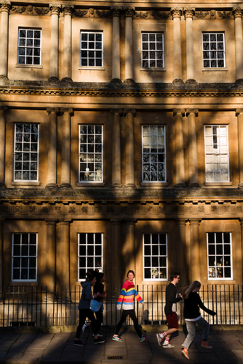 Joggers on The Circus, Bath, UK, February 16, 2016. The UNESCO World Heritage city of Bath is famed for its hot spa that dates back to Roman times and for its Georgian architecture. For much of its history the city has been a popular holiday resort. It is the only hot spa in the UK.