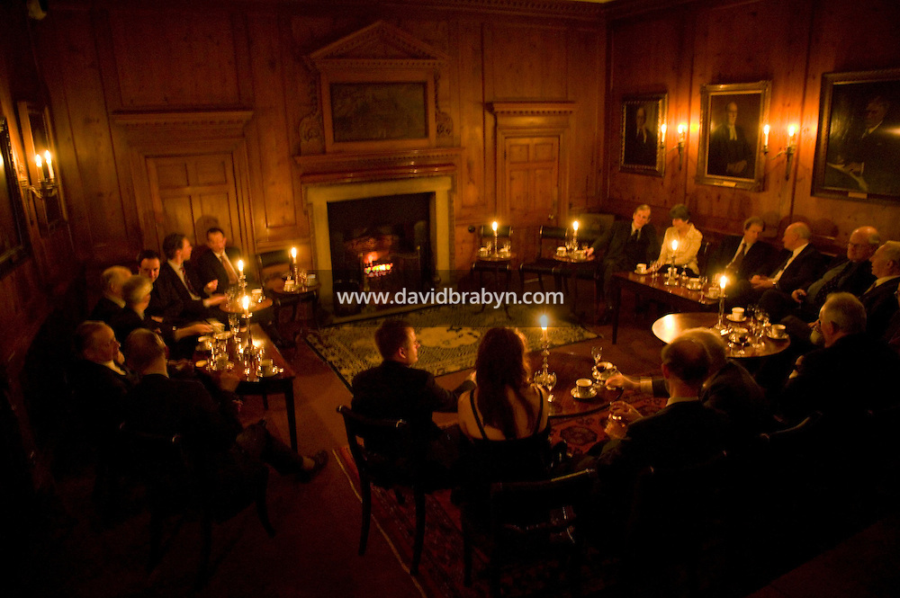 Fellows enjoy after-dinner drinks in the Large Combination room at Magdalene College in Cambridge, United Kingdom, 11 March 2007.