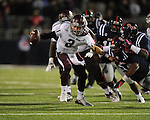 Texas A&amp;M quarterback Johnny Manziel (2) is chased by Ole Miss defensive end Channing Ward (11) and Ole Miss defensive lineman Issac Gross (94) at Vaught-Hemingway Stadium in Oxford, Miss. on Saturday, October 6, 2012. Texas A&amp;M rallied from a 27-17 4th quarter deficit to win 30-27.