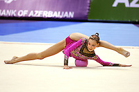 Dominika Cervenkova of Czech Republic extends at beginning of ball routine during All-Around competition at World Championships in Baku, Azerbaijan on October 8,  2005.  (Photo by Tom Theobald)