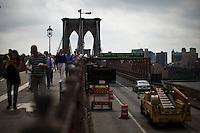 Tourist walk through the Brooklyn Bridge while it remains under maintenance one day before its 130th anniversary in New York,  May 23, 2013, Photo by Eduardo Munoz Alvarez / VIEWpress.