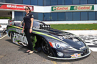 May 30, 2013; Englishtown, NJ, USA: NHRA funny car driver Alexis DeJoria poses in front of her car at Raceway Park. Mandatory Credit: Mark J. Rebilas-