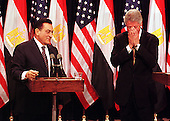 Washington, DC - July 1, 1999 -- United States President Bill Clinton and President Hosni Mubarak of Egypt react to a particularly difficult question during their joint press conference on 1 July, 1999.  The two leaders met for more than two hours in the Oval Office and over lunch in the White House residence.  .Credit: Ron Sachs / CNP
