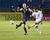 Michael Bradley (4) dribbles the ball past Guatemala's (11) Jose Manuel Contreras as the United States played Guatemala at Estadio Mateo Flores in Guatemala City, Guatemala in a World Cup Qualifier on Tue. June 12, 2012.