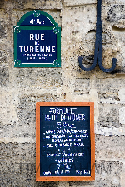 Street sign and Petit Dejeuner brasserie board, rue de Turenne, 4th arondissement, Paris, France