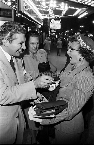 Liberace greets fans outside concert hall, Milwaukee, 1953. Photographer John G. Zimmerman