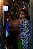 35 yr old Khatum stands in her tiny home on 21st Oct 2006. It measures approx 6&quot; x 12&quot;, she shares it along with her husband and six children. She describes her life as impossible, the money she gets from her husband, a shoe seller, is barely enough to survive on. Although some Dharavi resisdents have better sized homes for most there is barely enough room.