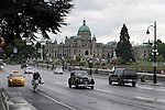 Oh, so British-ish! A vintage Rolls Royce, from Oregon no less, cruises through Victoria, B.C., with the Parliament building in the background.