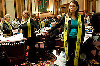 March 29, 2012, Atlanta, Georgia - A majority of Democratic House members, led by Democratic women draped with caution tape, stood with backs turned when the conference committee report was presented on HB 954.<br />