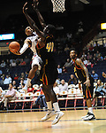 "Ole Miss' Dundrecous Nelson (5) is fouled by Grambling State's Peter Roberson (40) during the first half at the C.M. ""Tad"" Smith Coliseum in Oxford, Miss. on Monday, November 14, 2011."