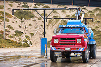A Peruvian water distribution worker fills a water truck with a drinking water from the central underground tank in Pachacútec, a desert suburb of Lima, Peru, 24 January 2015. Although Latin America (as a whole) is blessed with an abundance of fresh water, having 20% of global water resources in the the Amazon Basin and the highest annual rainfall of any region in the world, an estimated 50-70 million Latin Americans (one-tenth of the continent's population) lack access to safe water and 100 million people have no access to any safe sanitation. Complicated geographical conditions (mainly on the Pacific coast), unregulated industrialization (causing environmental pollution) and massive urban poverty, combined with deep social inequality, have caused a severe water supply shortage in many Latin American regions.